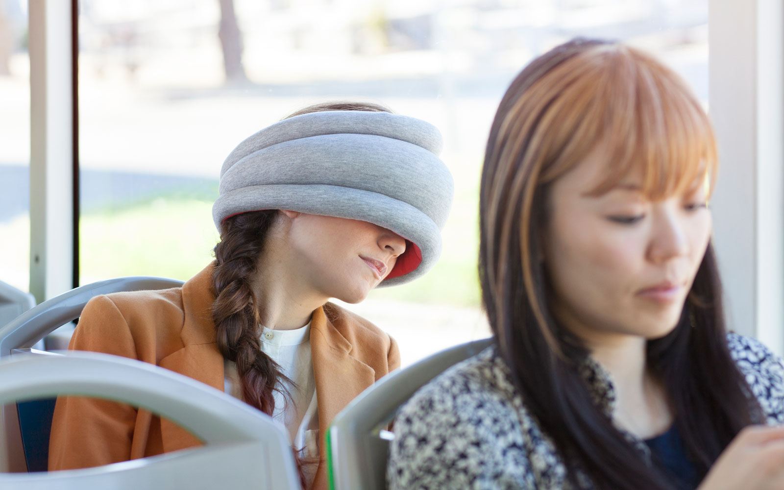 Ostrich pillow can help you sleep on flights.