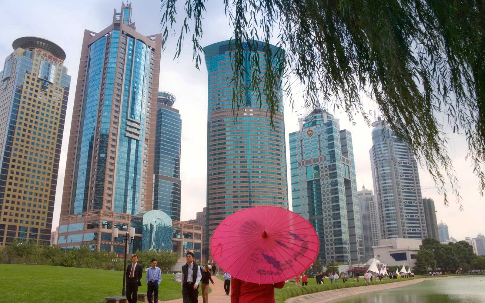 Woman with umbrella in Century Park, Pudong area, Shanghai