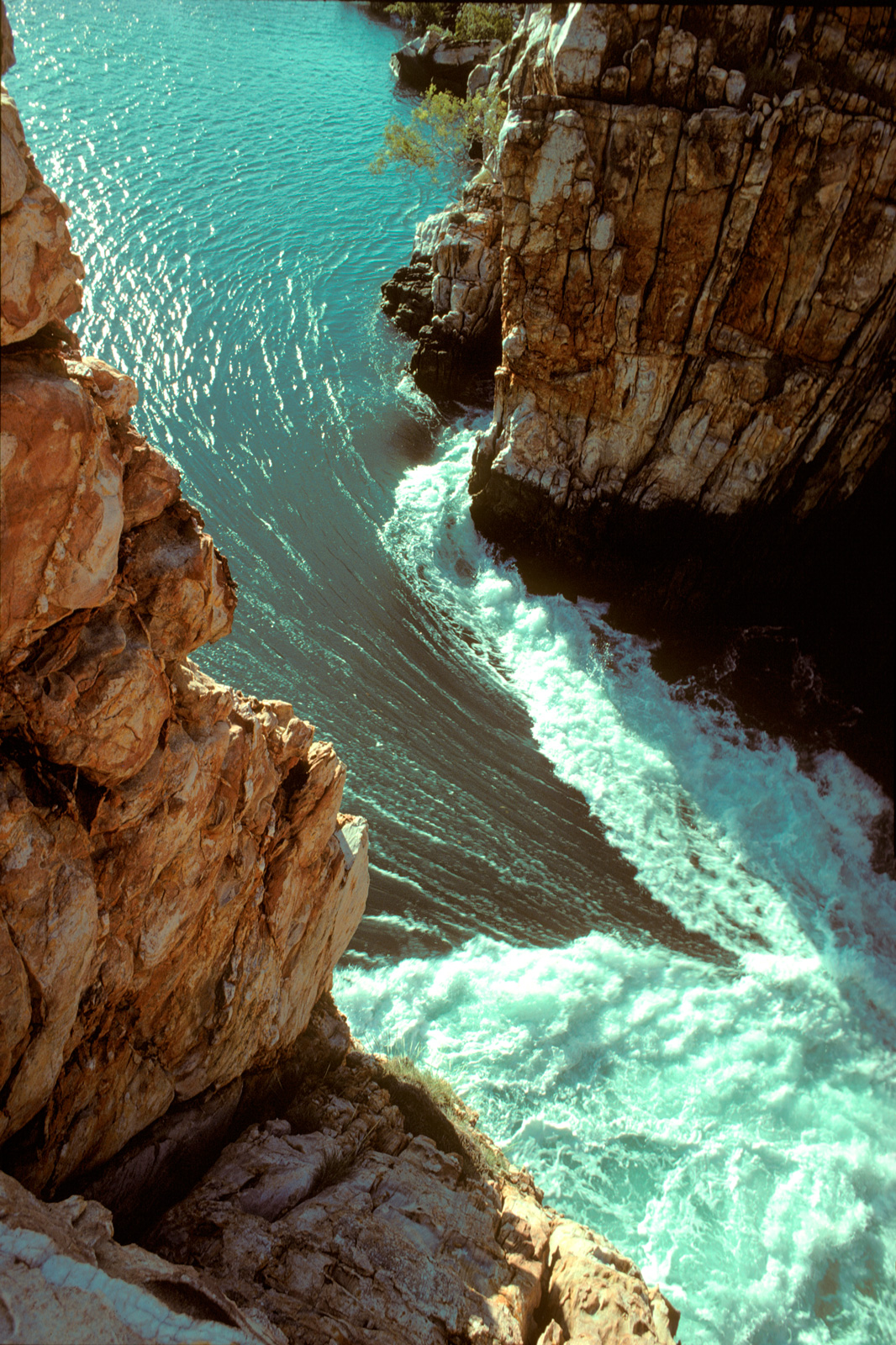 Tide-race or horizontal waterfall, vertical view into the throat of the most powerful tide-race in the world. It is a drowned river gorge. Twice a day a tidal variation of up to 10 m empties and fills two land-locked valleys with water from Talbot Bay.