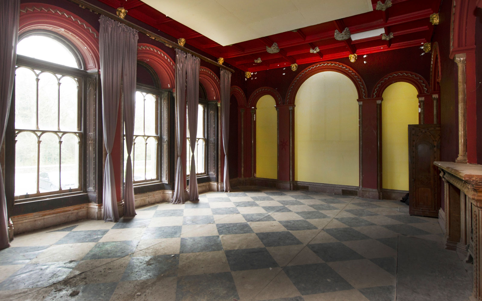 The interiors of Gosford Castle include wide entryways and fireplaces dating to the 1800s.