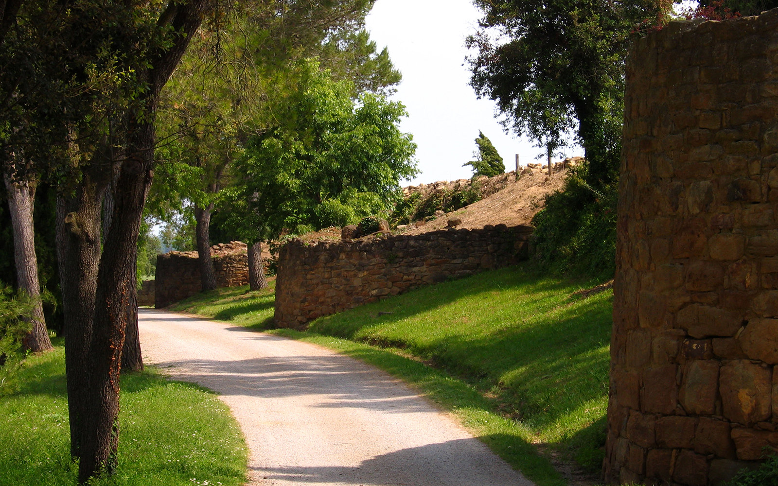 country road and old ruins in Ullastret, Spain