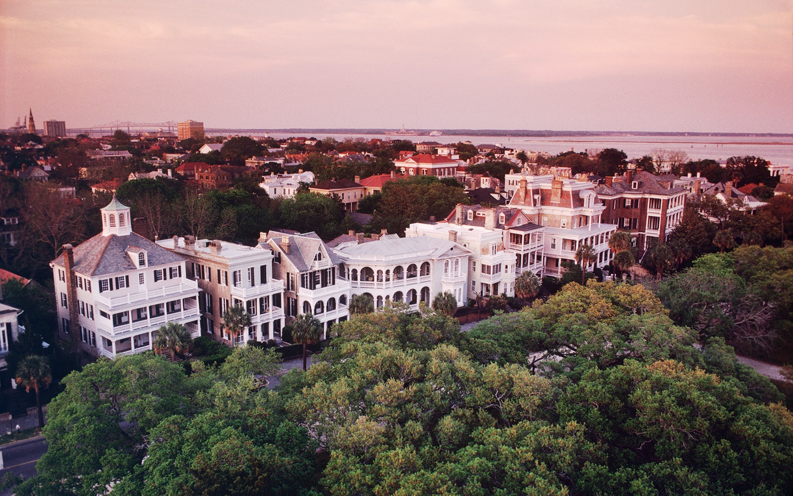 ATD8E8 Aerial view of rows of victorian houses found along the Battery in historic Charleston South Carolina at sunset