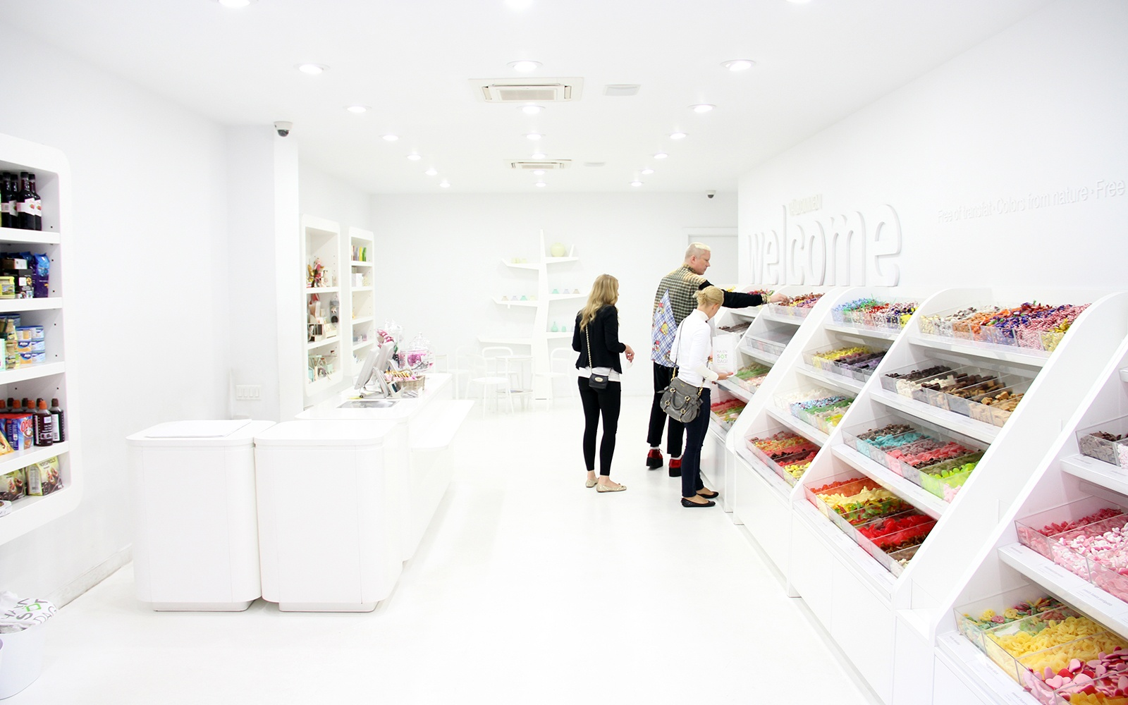 People Shopping in a Colorful Candy Store