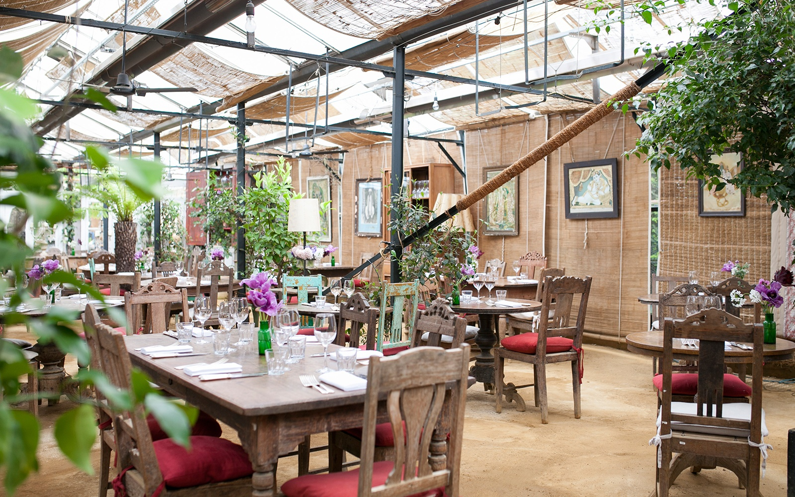 Cecconi's is an outdoor restaurant decorated like a private garden ...