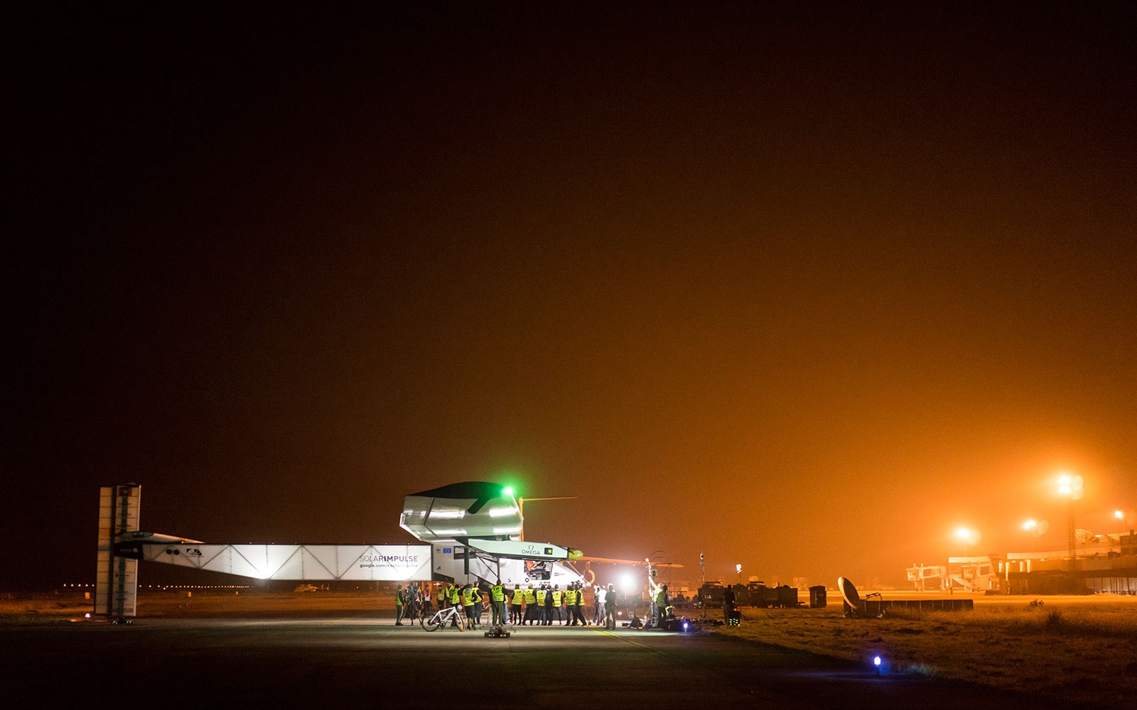 Varanasi, India, March 18, 2015: Solar Impusle 2 takes-off for its 4th flight from Varanasi to Mandalay (Myanmar) with Bertrand Piccard at the controls. The First Round-the-World Solar Flight will take 500 flight hours and cover 35'000 km, over five months. Swiss founders and pilots, Bertrand Piccard and André Borschberg hope to demonstrate how pioneering spirit, innovation and clean technologies can change the world. The duo will take turns flying Solar Impulse 2, changing at each stop and will fly over the Arabian Sea, to India, to Myanmar, to China, across the Pacific Ocean, to the United States, over the Atlantic Ocean to Southern Europe or Northern Africa before finishing the journey by returning to the initial departure point. Landings will be made every few days to switch pilots and organize public events for governments, schools and universities.