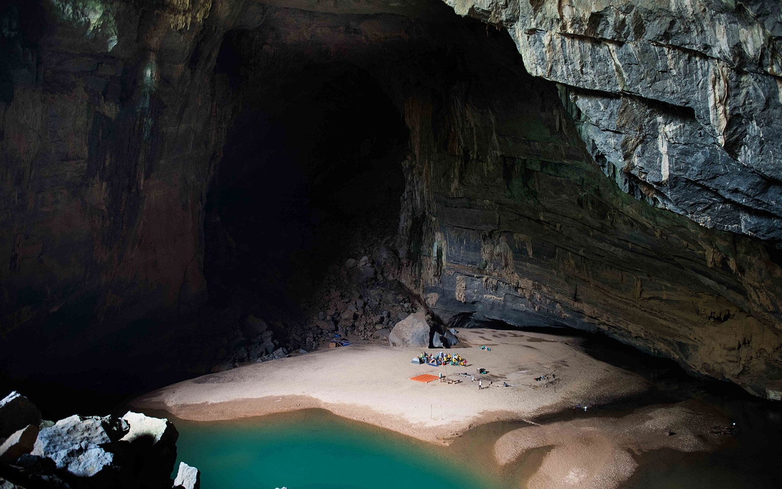 Hang En is the first cave on the Son Doong experience. Trekkers camp here on night one before following the river through the cave and onwards toward Son Doong itself