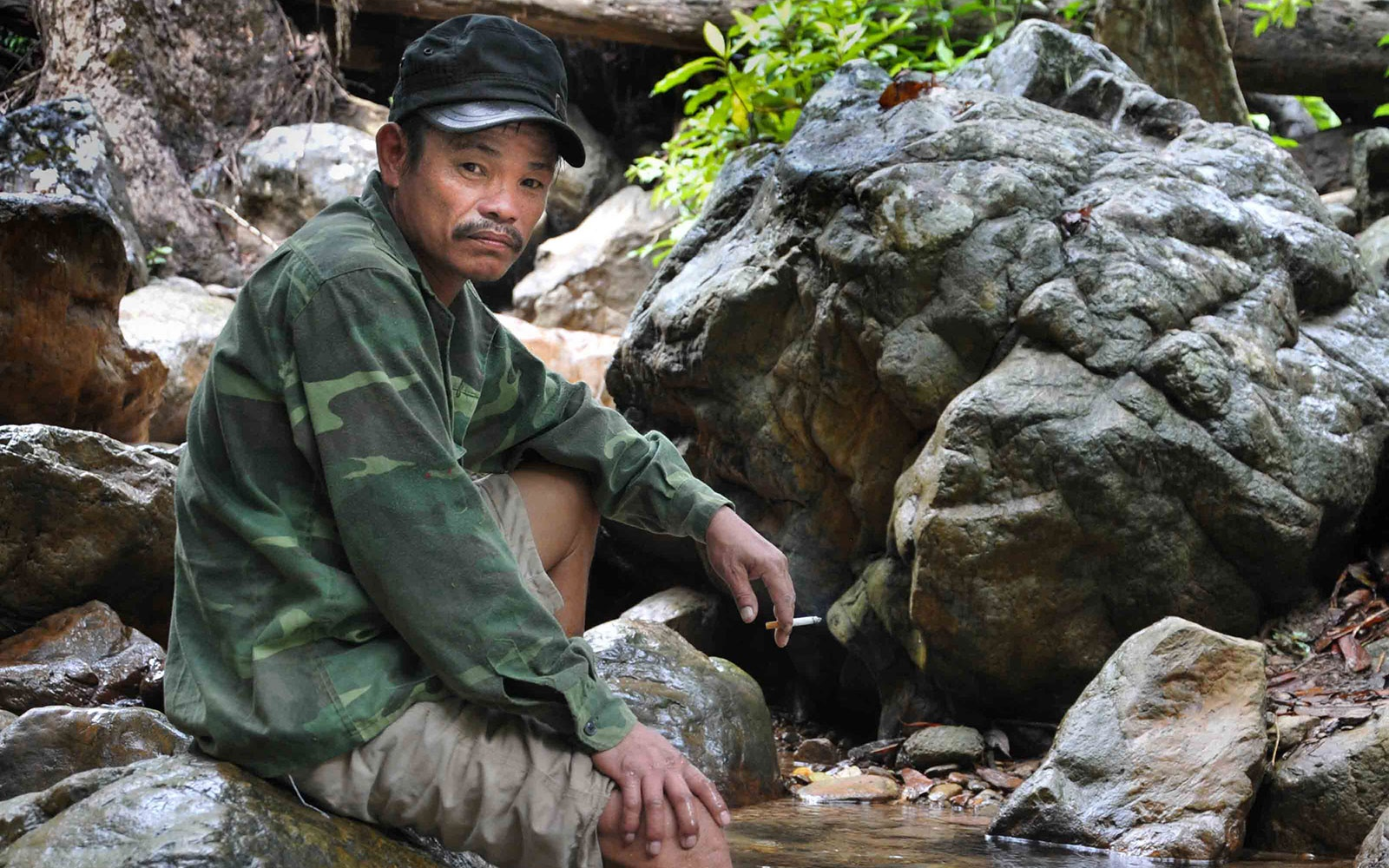 A porter enjoys a cigarette after the steep decent to the valley floor.