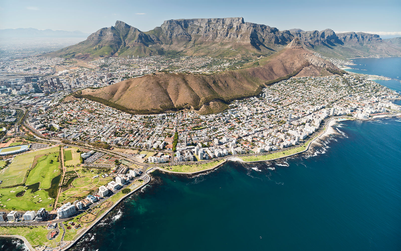 view from a helicopter on to Cape Town; Table Mountain; Lions Head; Signal Hill; Devil's Peak; Green Point; Twelve Apostles; South Africa