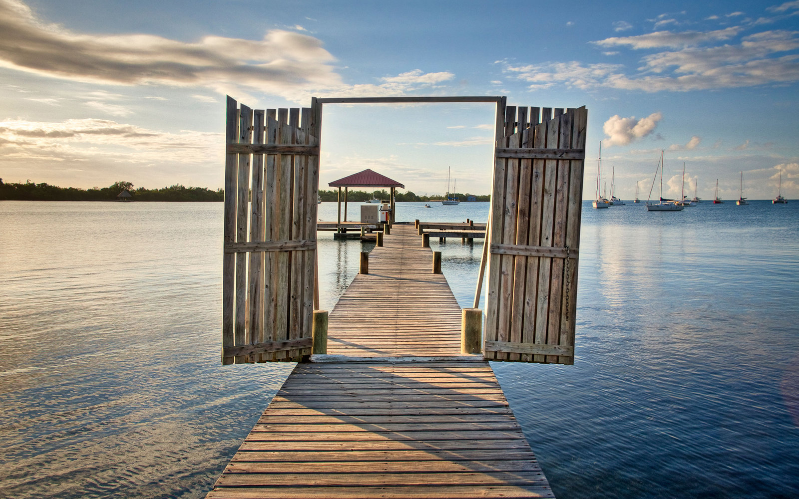 BHGYX4 main dock at sunrise in Placencia, Belize