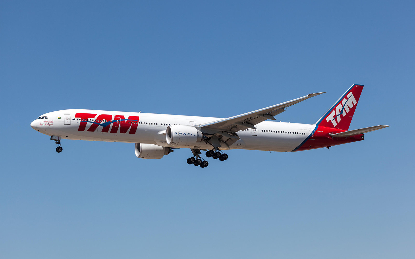Boeing 777-300ER airplane of the Brazillian TAM airline landing at Frankfurt Airport