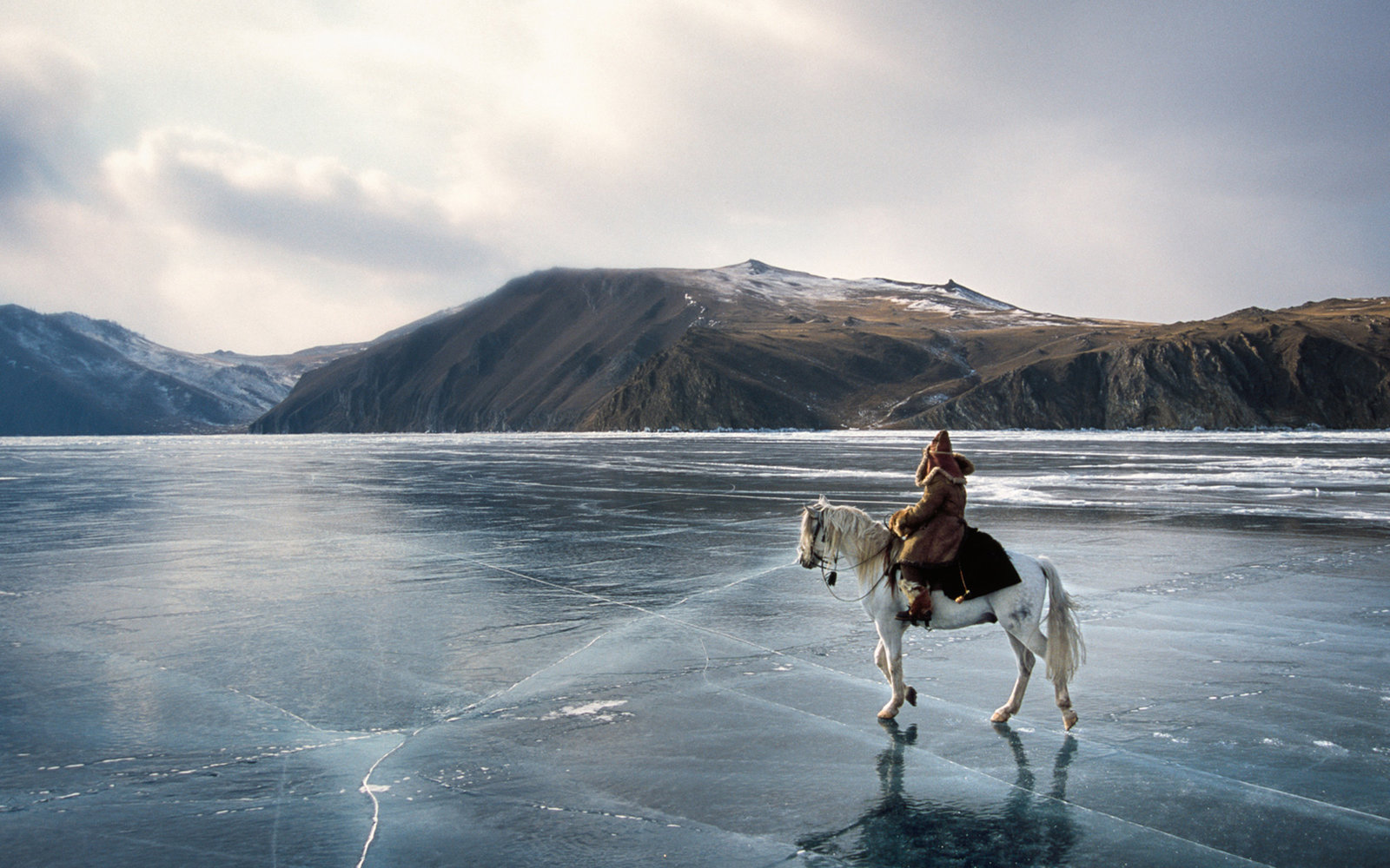 "On the shooting of ""Serko"", a film reenacting the longest horse-ride ever done in the history of man, : 9000 Km in 200 days from the Amur River to St Petersburg, by a Cossack named Dimitri Petchkov and his horse Serko  in the winter of 1890. Siberia, Irku"