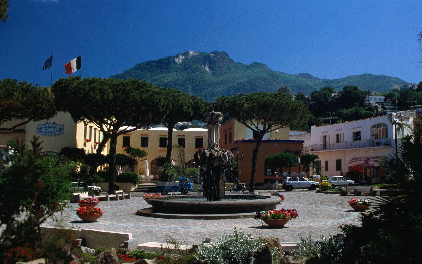 Fountain in the middle of the town square, Monte Epomeo in the background - Lacco Ameno, Isola d'Ischia, Golfo di Napoli, Campania