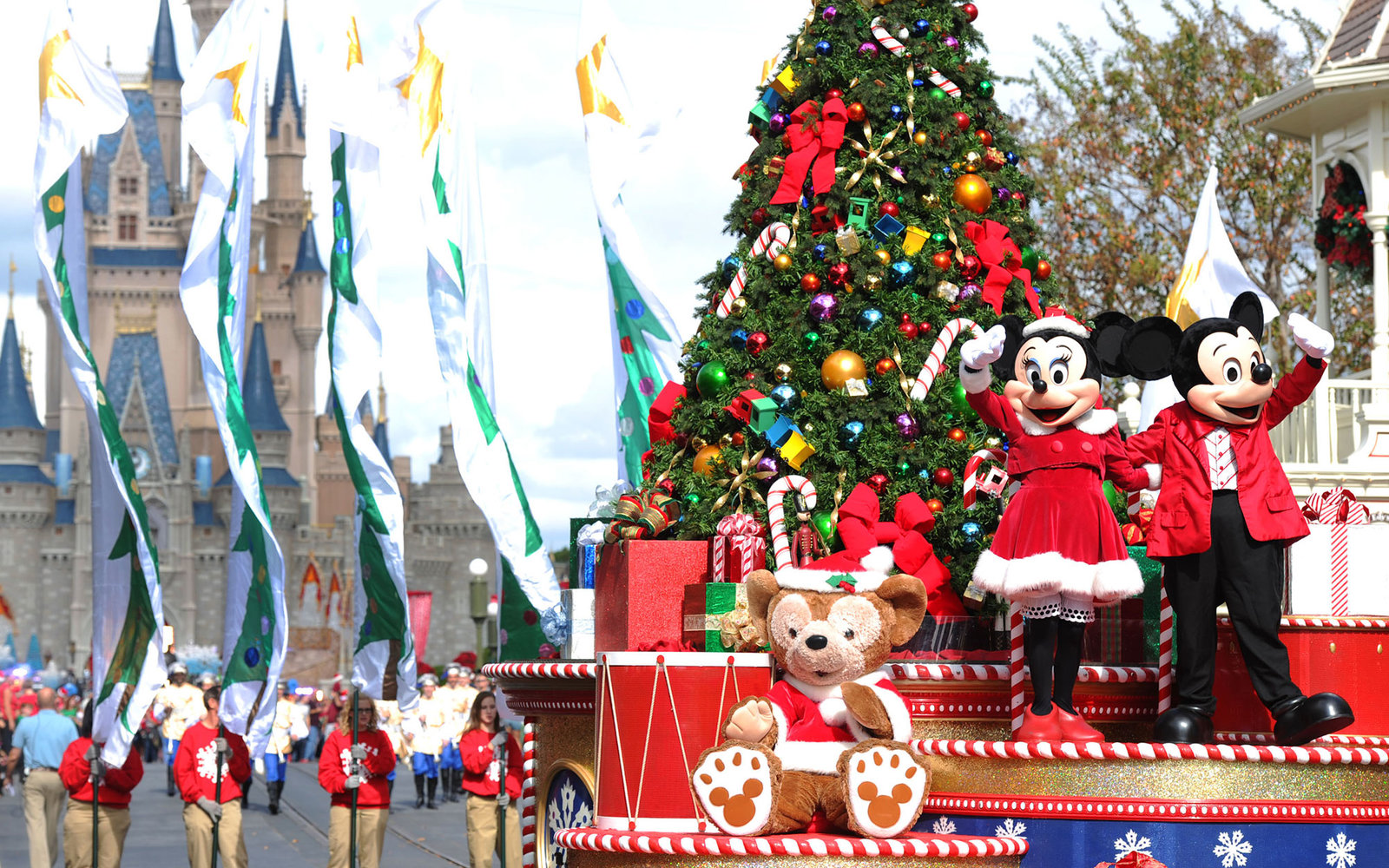 "LAKE BUENA VISTA, FL - DECEMBER 01:  In this handout photo provided by Disney, Mickey and Minnie Mouse wave to the crowd while taping the ""Disney Parks Christmas Day Parade"" TV special in the Magic Kingdom park at Walt Disney World on December 1,2012 in L"