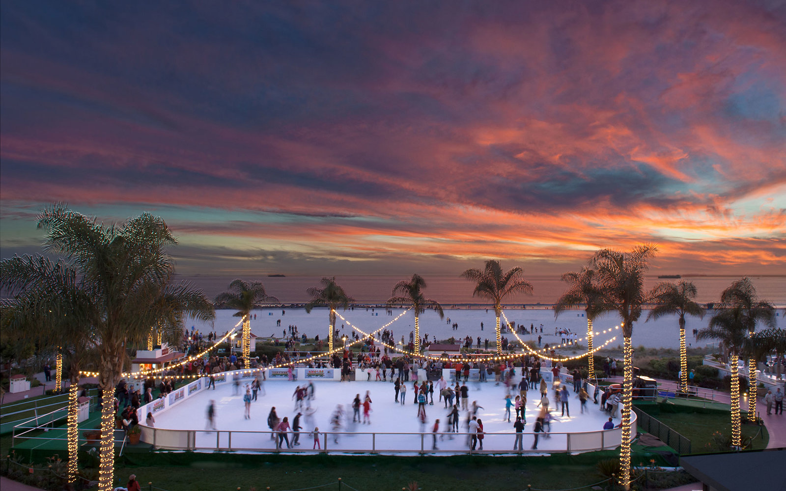 The ice skating rink at the Hotel Del Coronado is photographed at sunset by William Morton Visuals.