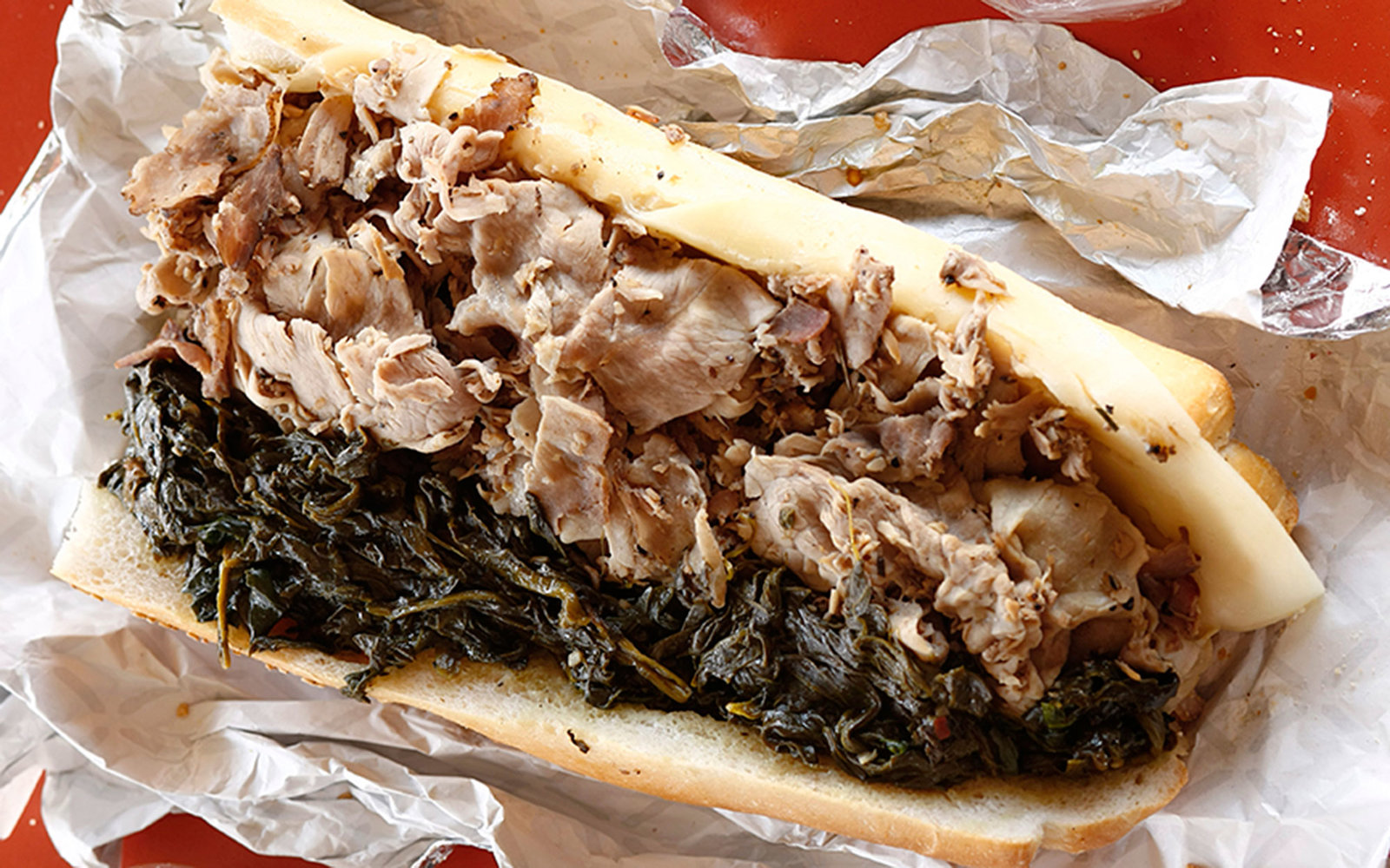 Cheesesteaks and hoagies may get all of the attention, but roast pork sandwiches are also big business in Philly. It's the specialty of the house at John's Roast Pork in South Philly, which often serves it topped with broccoli rabe.