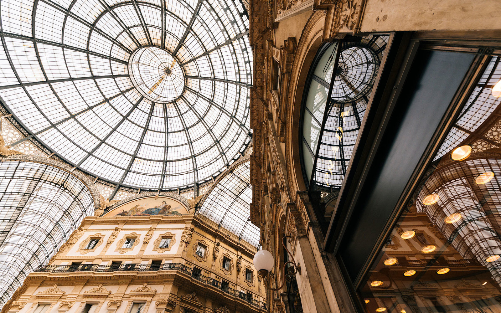 Low angle view of Galleria Vittorio Emanuele shopping mall, Milan, Lombardy, Italy