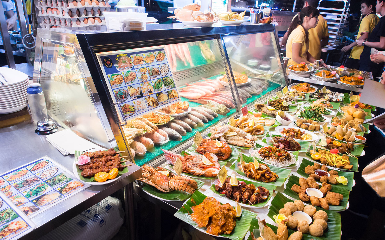 SINGAPORE - MARCH 08: Street foods in Singapore. Inexpensive food stalls are numerous in the city so most Singaporeans dine out at least once a day.. Singapore, March 08,2014; Shutterstock ID 184492361