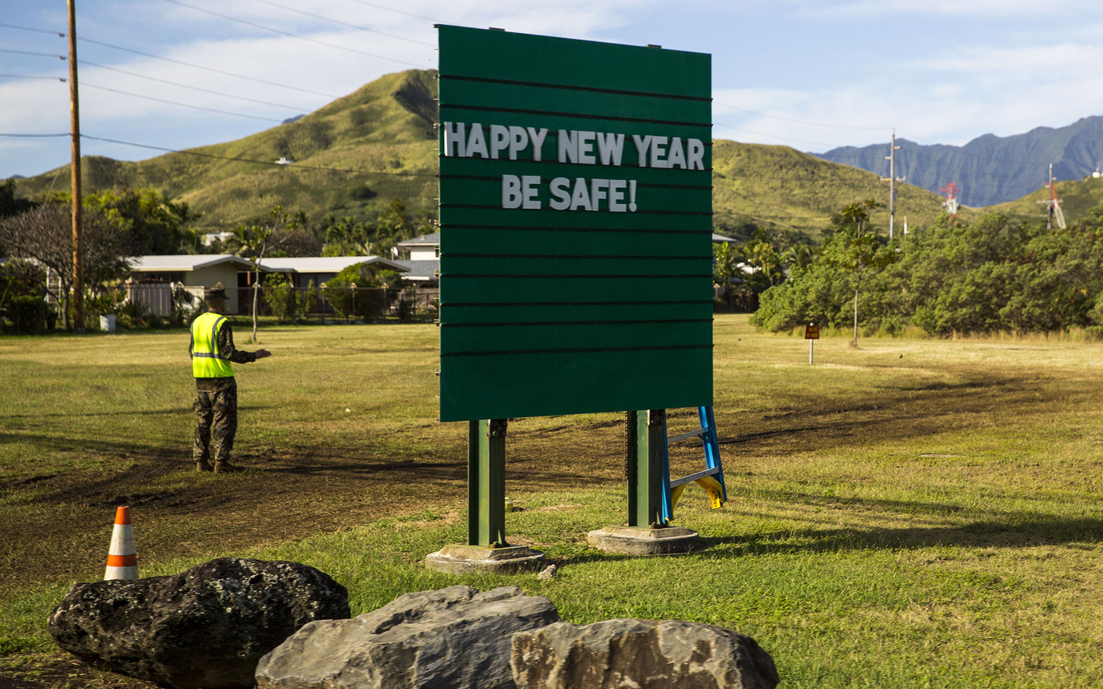 A sign at Marine Corps Base Hawaii wishing drivers a Happy New Year is seen as US President Barack Obama's motorcade departs Marine Corps Base Hawaii, returning to his vacation compound, on December 31, 2014 in Kaneohe, Hawaii.  The First Family is vacati