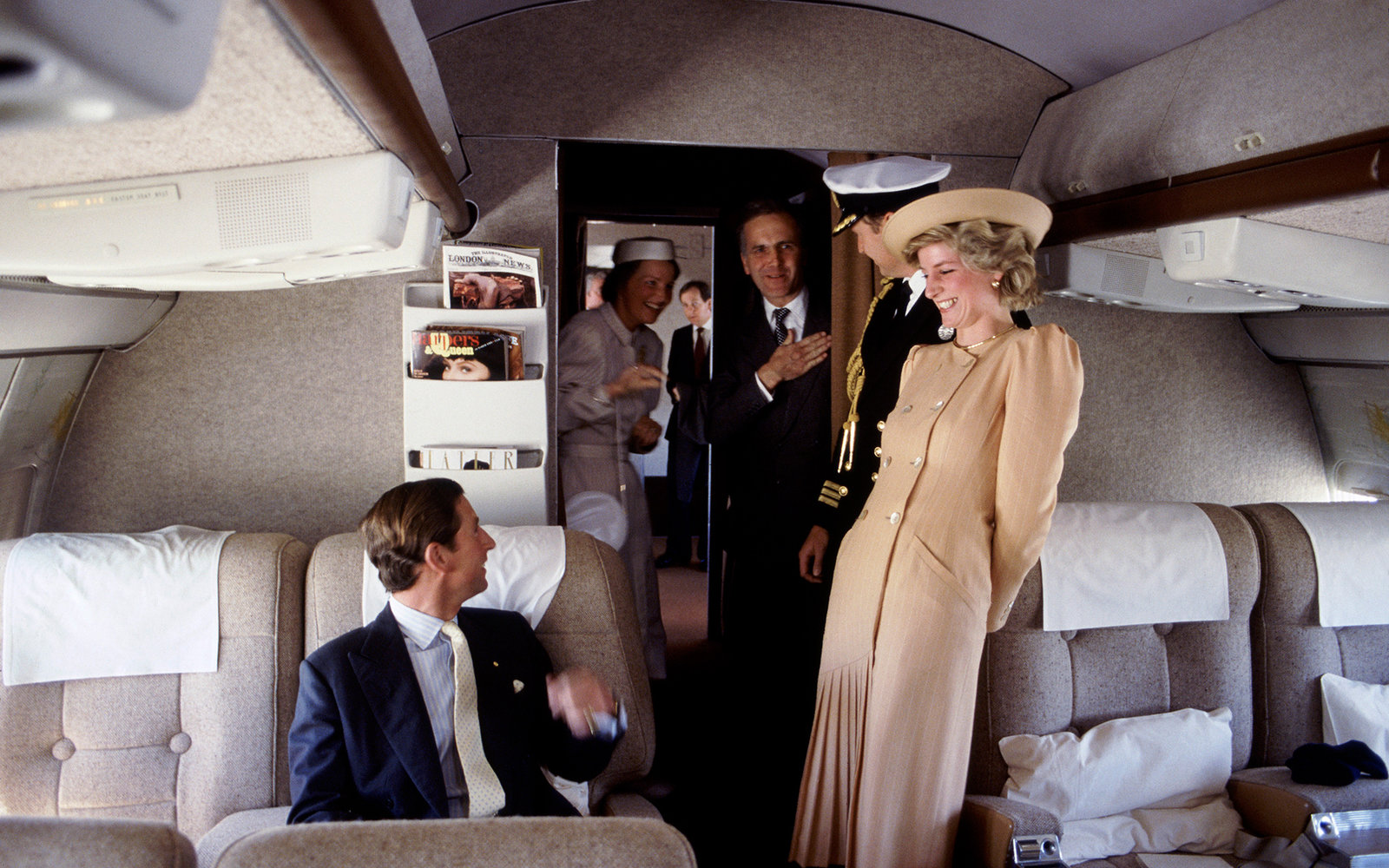 AUSTRALIA - OCTOBER 27:  The Prince And Princess Of Wales On Board A Royal Flight To Australia, Laughing With Their Staff  (Photo by Tim Graham/Getty Images)