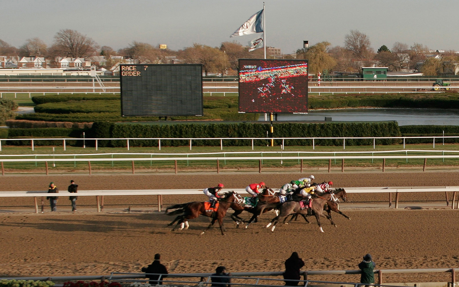 UNITED STATES - NOVEMBER 28:  Horses and jockeys compete at the Aqueduct Racetrack in the Queens borough of New York on Saturday, November 26, 2005.  (Photo by Andrew Harrer/Bloomberg via Getty Images)