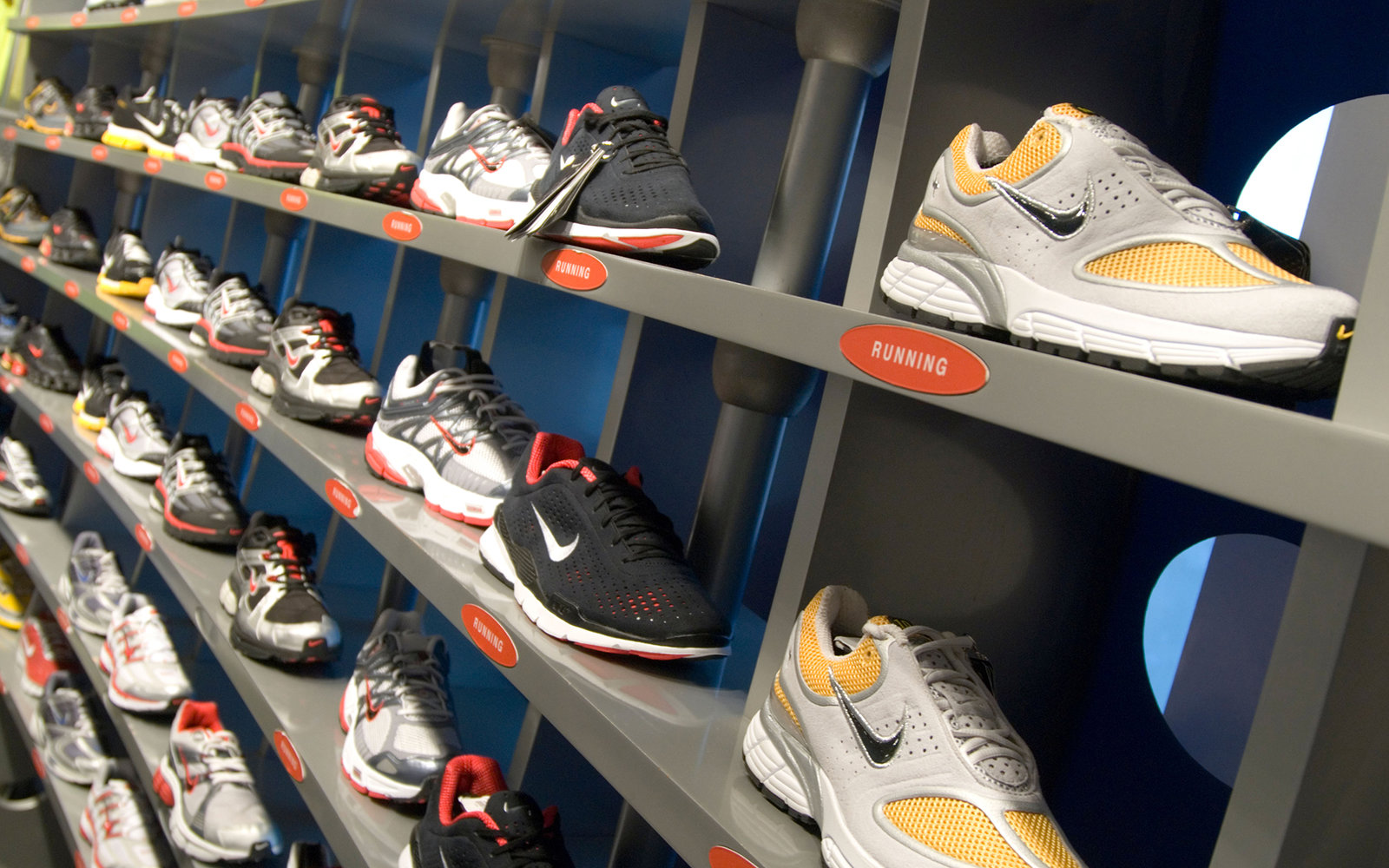 A0BG7X Rows of Nike trainers in Niketown London England UK