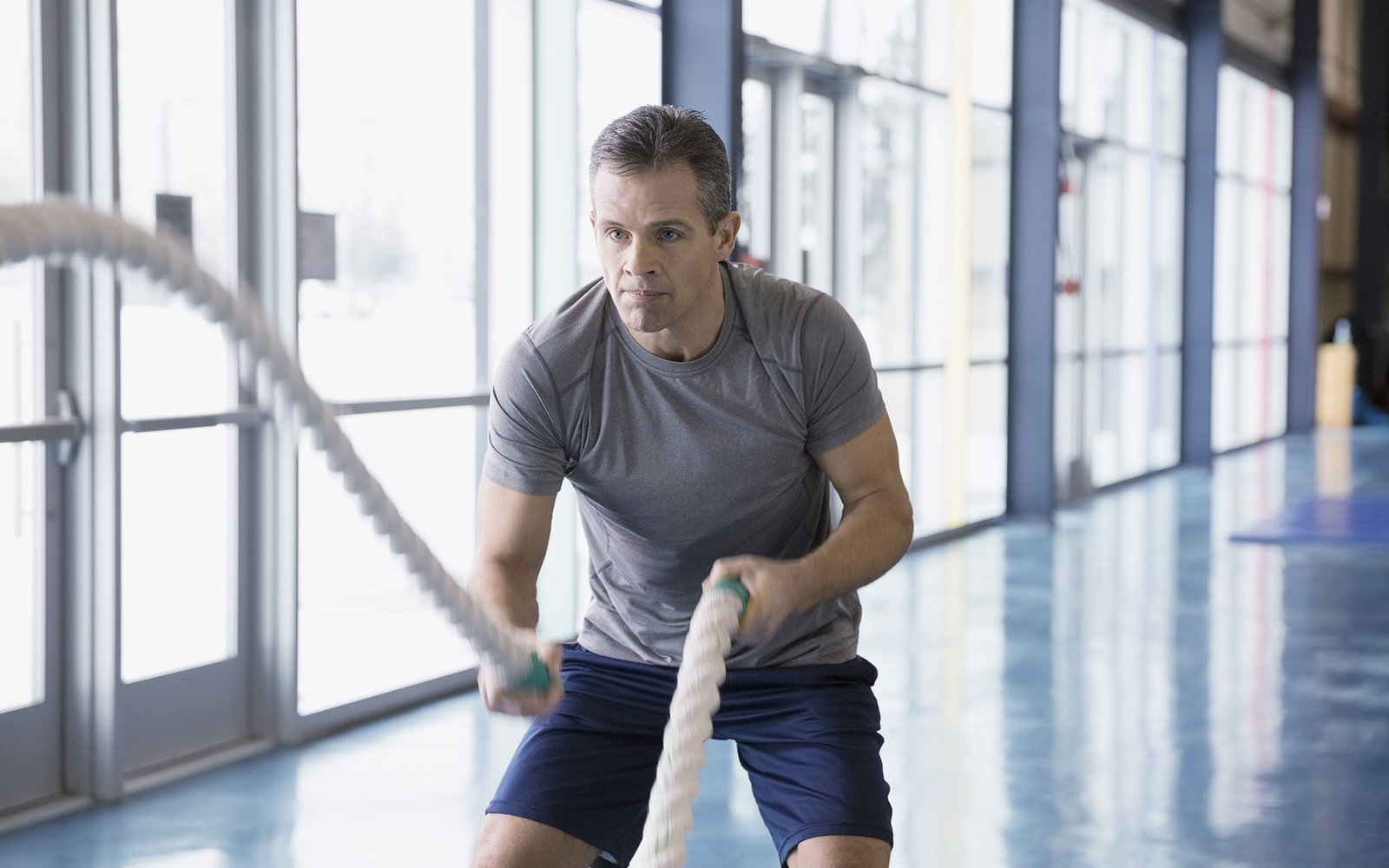 Man training with ropes at gym