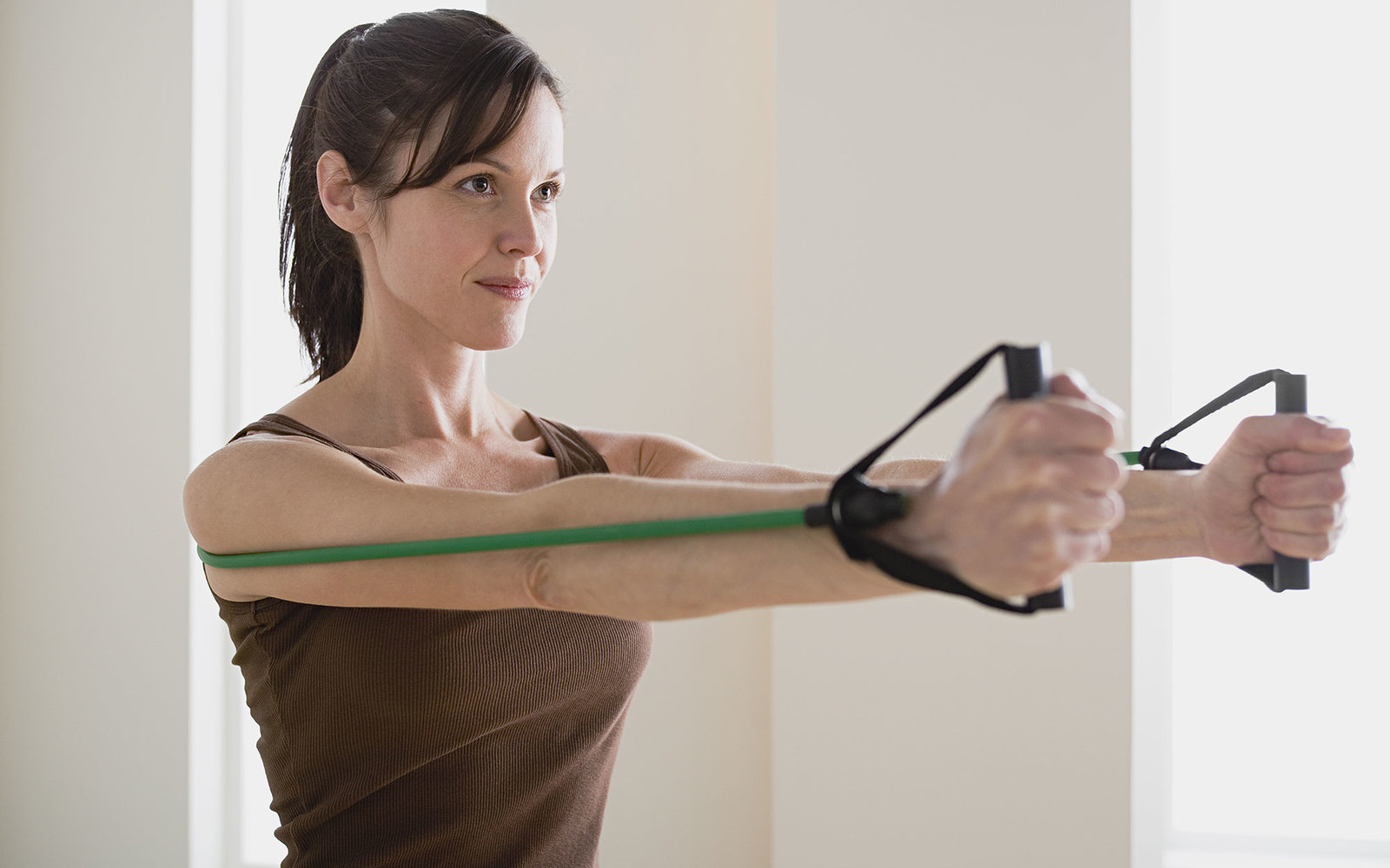 Los Angeles, California, USA, Woman exercising with resistance band