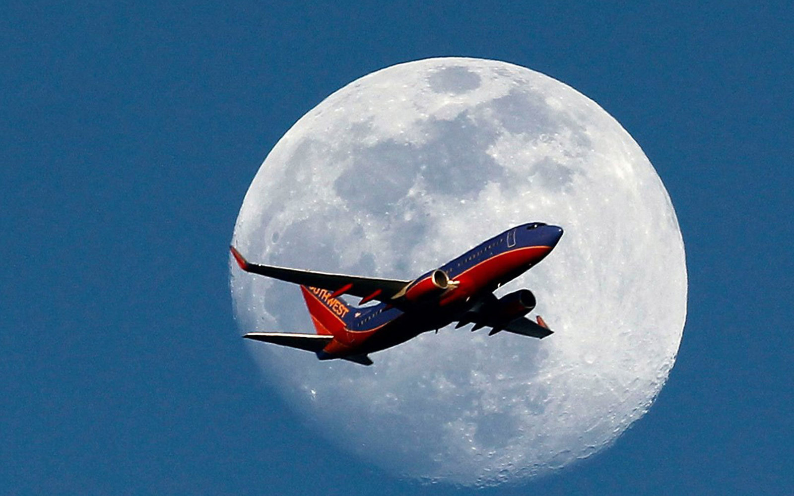 Photographers Capture Images of Airplanes Against the Full Moon
