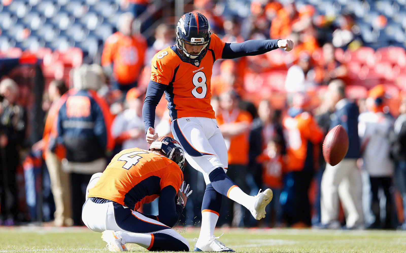 DENVER, CO - JANUARY 24:  Kicker Brandon McManus #8 of the Denver Broncos warms up before the AFC Championship game against the New England Patriots at Sports Authority Field at Mile High on January 24, 2016 in Denver, Colorado. The Broncos defeated the P