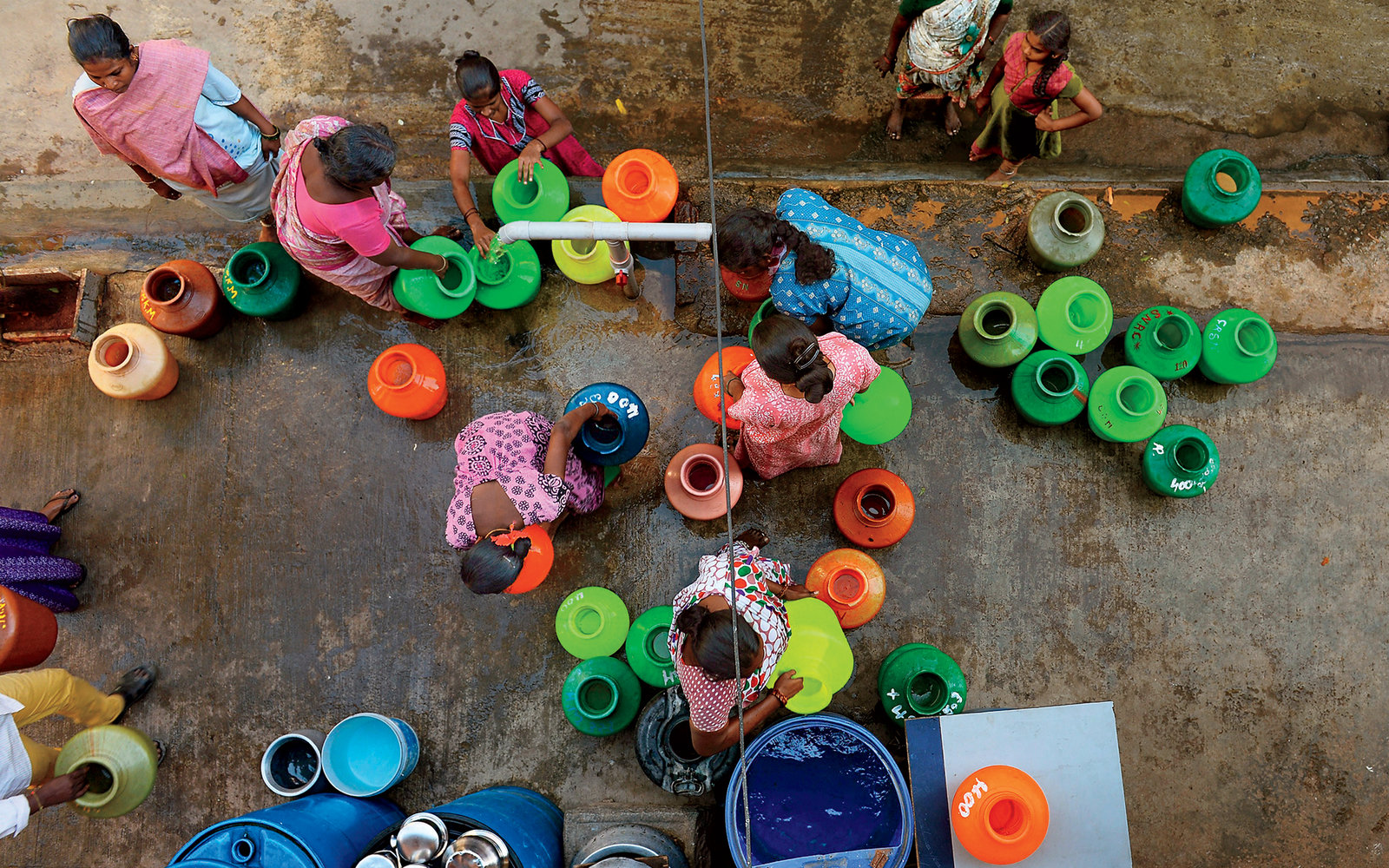 This photo taken on March 18, 2015 shows residents in Bangalore waiting to collect drinking water in plastic pots from a community tap. A new UN report launched in New Delhi on March 20 ahead of World Water Day on March 22 warned of an urgent need to mana