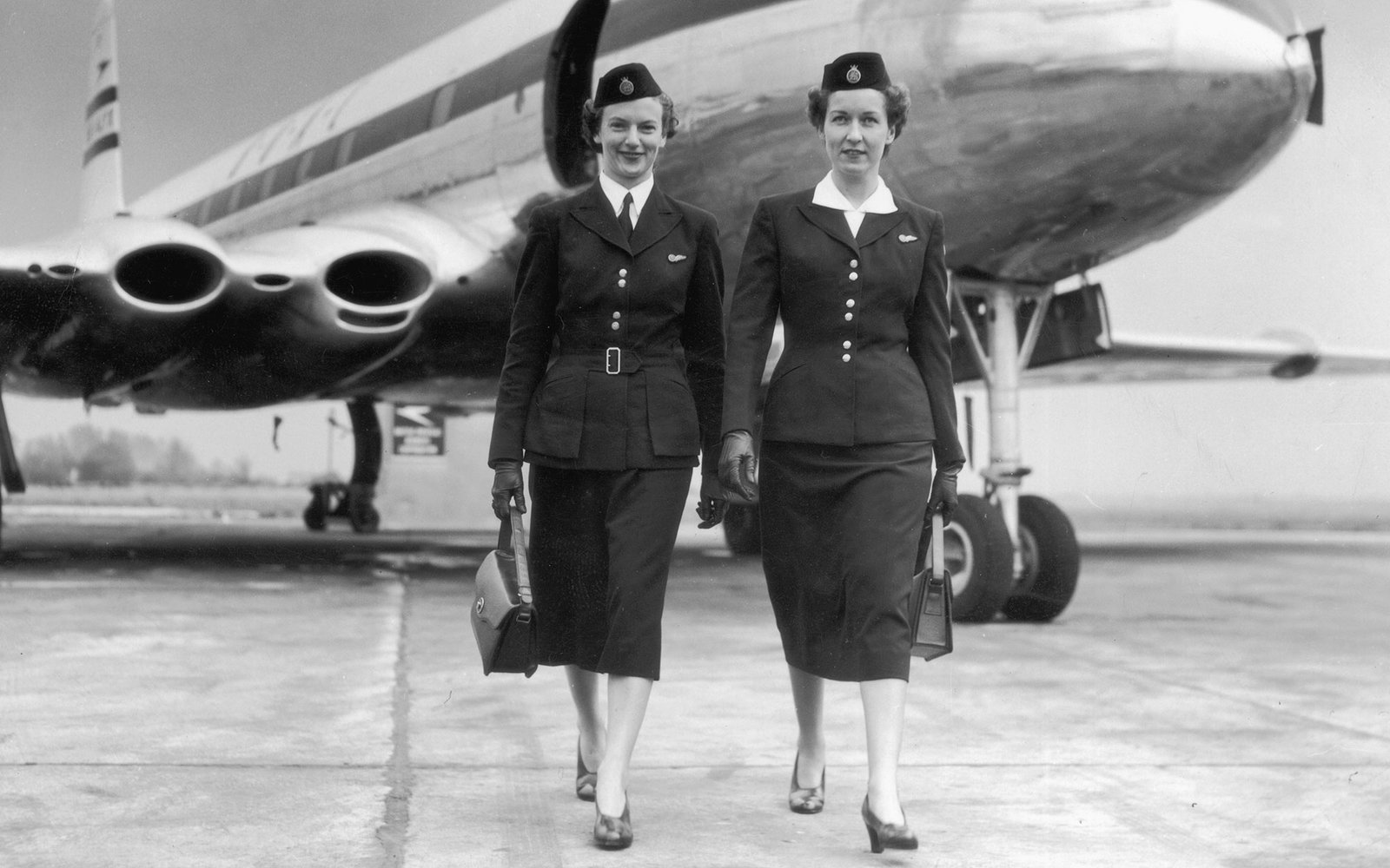 Two air hostesses walking away from a BOAC Comet, circa 1950. (Photo by Hulton Archive/Getty Images)