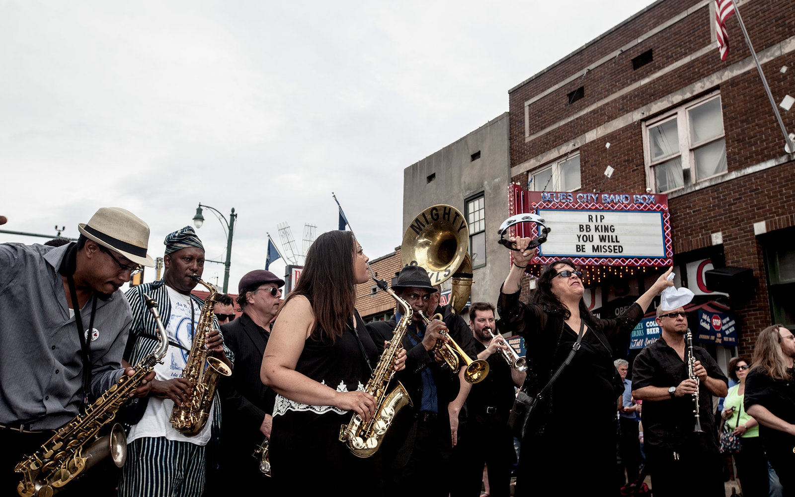 MEMPHIS, TN - MAY 27: The Mighty Souls Brass Band perform in the processional down Beale Street following the memorial in honor of B.B. King on May 27, 2015 in Memphis, Tennessee. King passed away on May 14, 2015 at the age of 89. (Photo by Andrea Morales