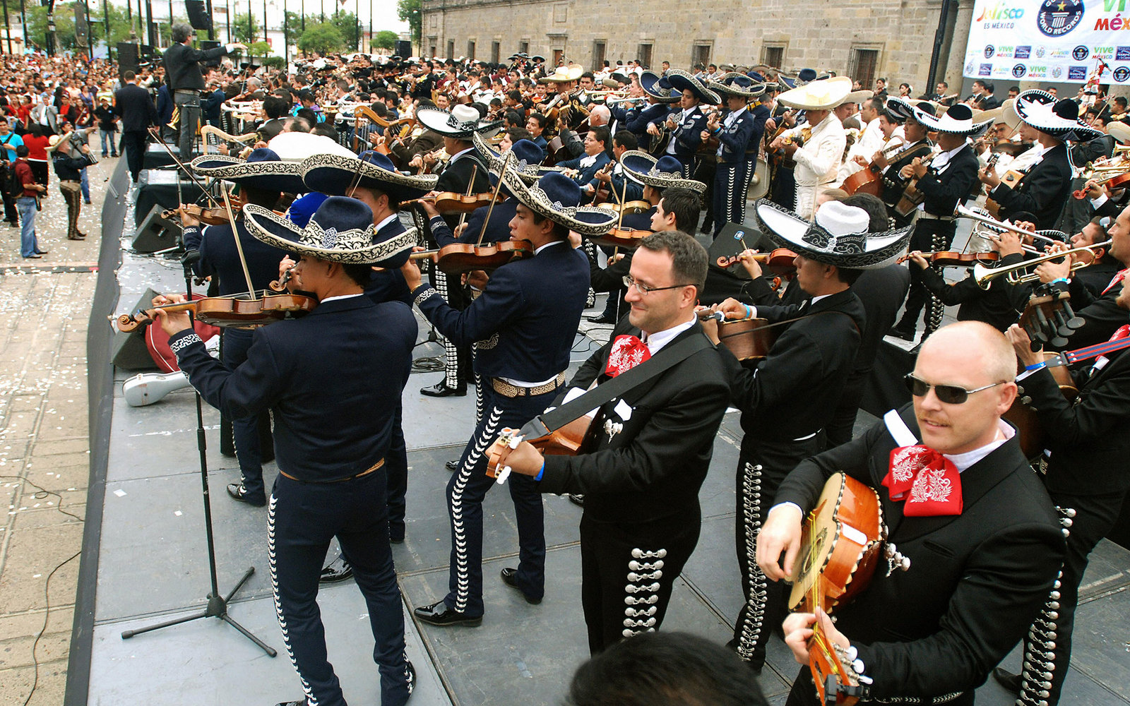 """View of part of the 549 """"Mariachis"""" who performed to break the Guinness World Record of """"Mariachis"""" playing at the same time on August 30, 2009 in Guadalajara, Mexico in the framework of the Mariachi's International Festival.  AFP PHOTO/Ivan Garcia (Photo"""