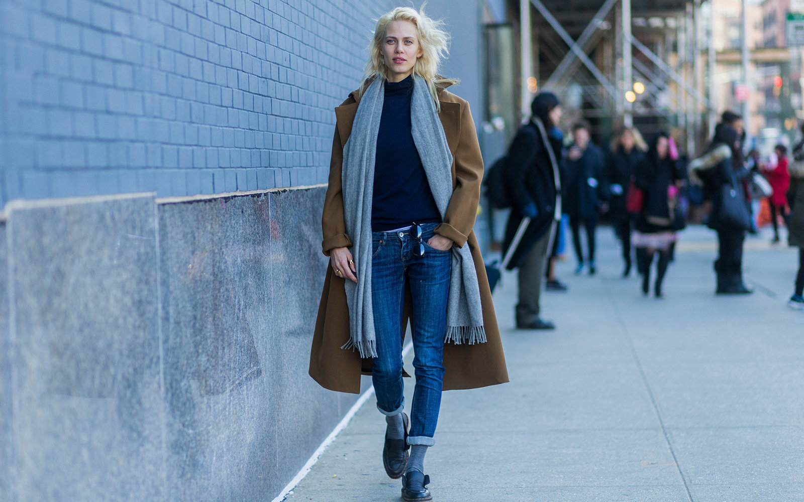 NEW YORK, NY - FEBRUARY 13:  French model Aymeline Valade wearing dark blue denim jeans, a grey scarf and a brown coat seen outside Lacoste during New York Fashion Week: Women's Fall/Winter 2016 on February 13, 2016 in New York City.  (Photo by Christian