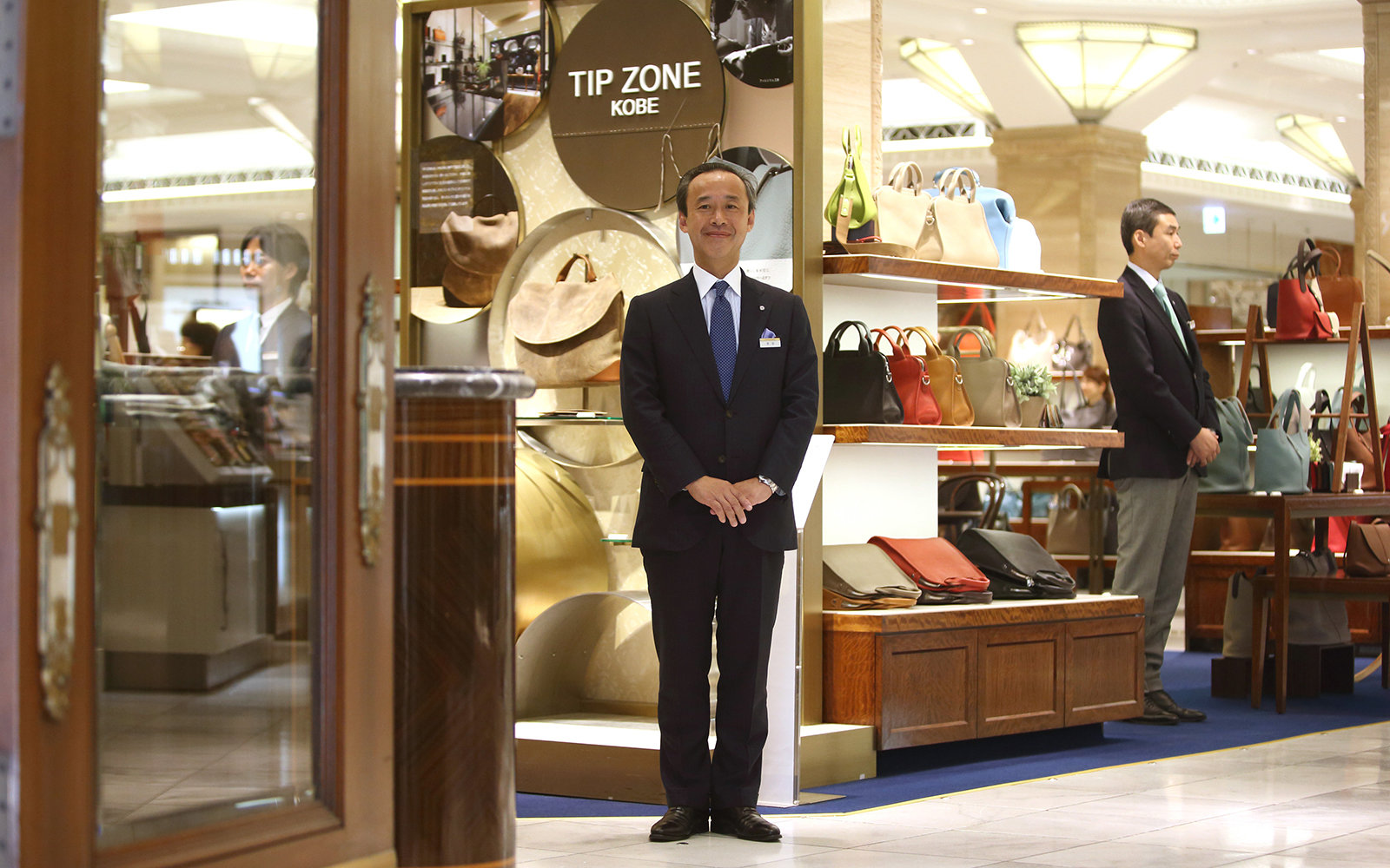 Employees prepare to welcome customers ahead of the day's opening at the Mitsukoshi department store, operated by Isetan Mitsukoshi Holdings Ltd., in the Nihonbashi district of Tokyo, Japan, on Monday, June 29, 2015. With Japan facing a labor shortage as