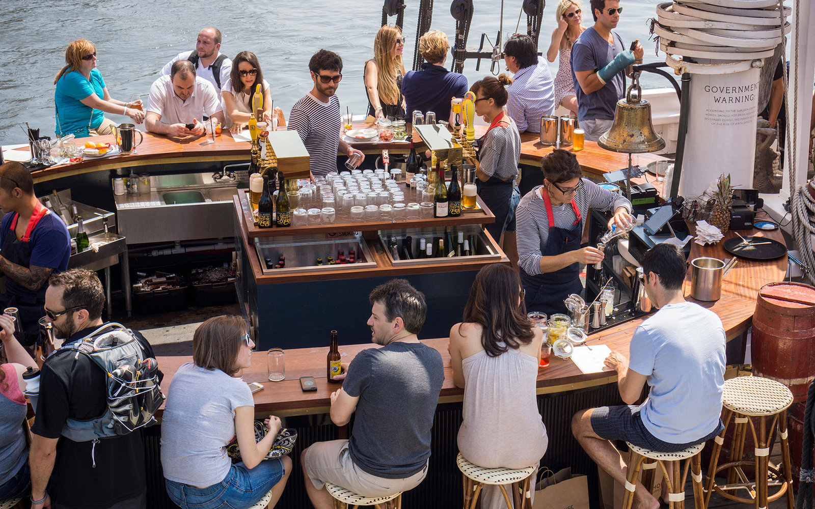 E4RYT5 Diners enjoy drinks and oysters aboard the Grand Banks restaurant on the schooner Sherman Zwicker docked in Hudson River Park