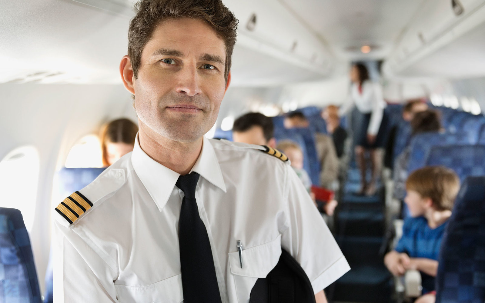 Portrait of male pilot in airplane cabin