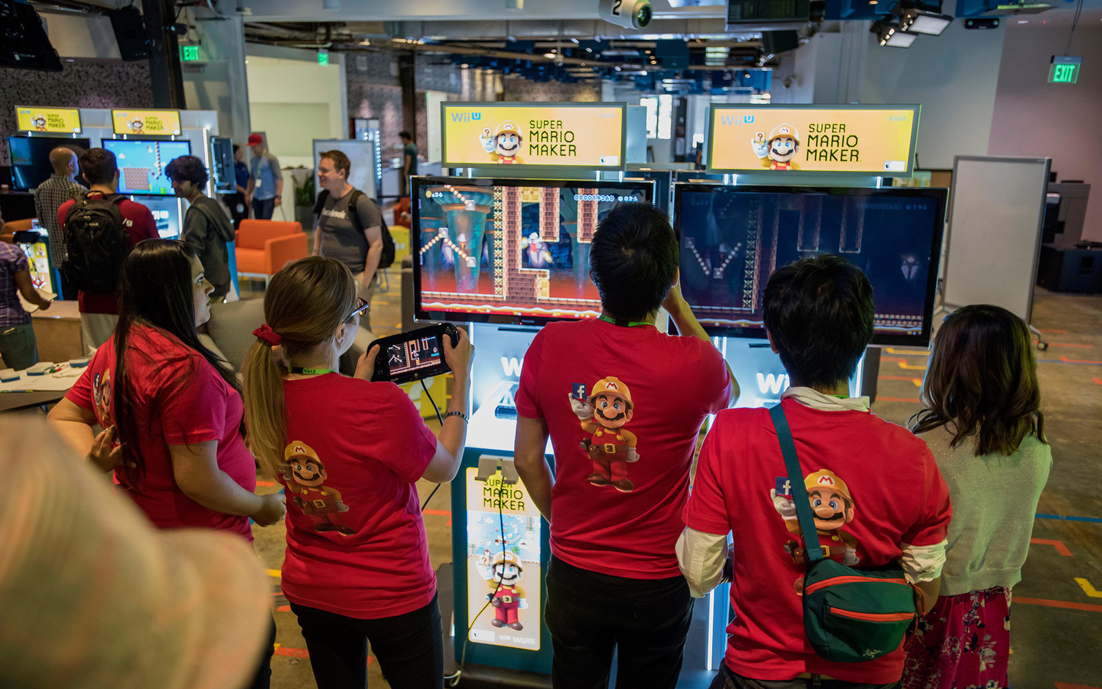 Nintendo Co. employees play the Super Mario Maker video game during a hackathon at the Facebook Inc. headquarters in Menlo Park, California, U.S., on Wednesday, July 29, 2015. Nintendo Co. jumped the most in four months after returning to quarterly profit