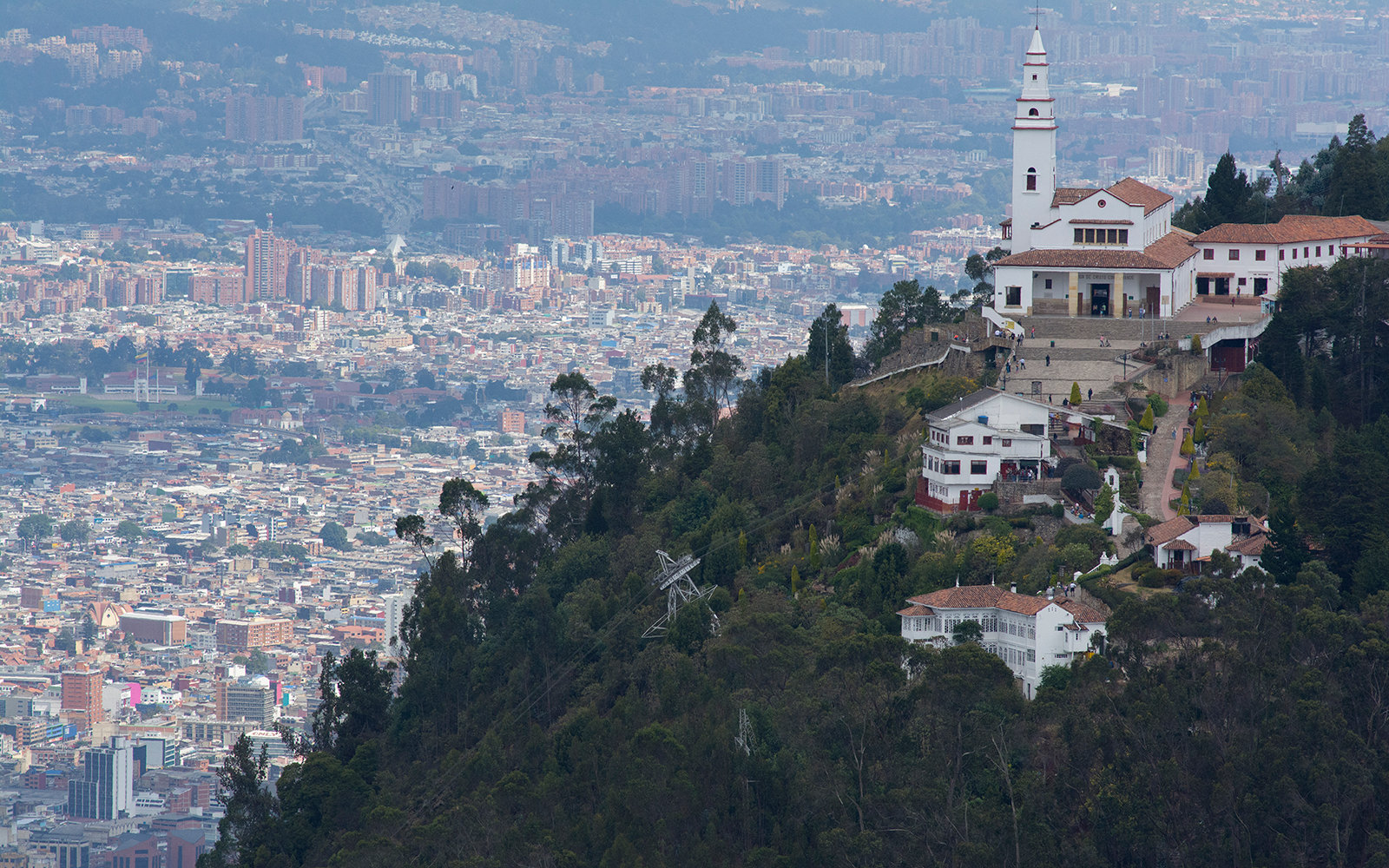 BOGOTA, COLOMBIA - FEBRUARY 23:  View of the church on the Monserrate mountain (10,341 ft) and the capital city from the 'Santuario de la Virgen de Guadalupe' on February 23, 2016 in Bogota, Colombia. The sanctuary  sits on the Guadalupe hill overlooking