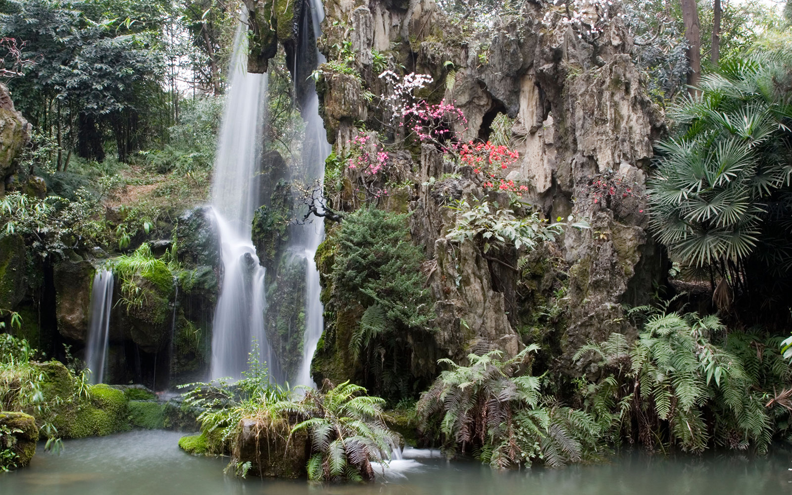 An artificial waterfall at the garden of Da Fu Cottage in Chengdu in Sichuan in China.