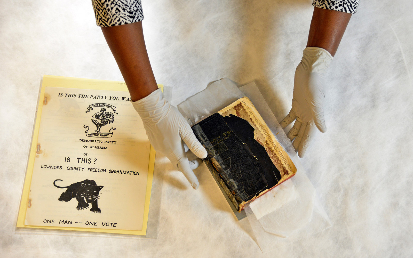 HYATTSVILLE, MD   JANUARY 28:Renee Anderson, head of collections, handles a Buffalo Soldiers bible from around 1913 and a 1966 pamphlet for the Black Panther Party of Lowndes County, Alabama, a couple of the artifacts destined for the Smithsonian's Natio
