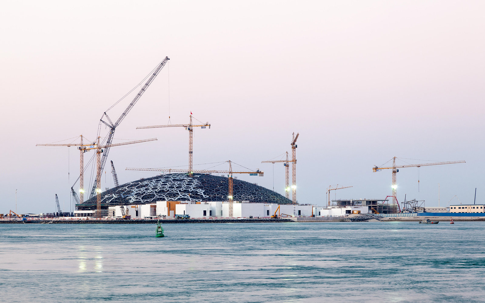 Louvre Abu Dhabi museum construction site at dusk