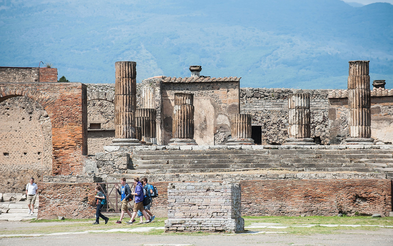 POMPEI, ITALY - APRIL 12:  Tourists visit the ruins of the 'Tempio di Giove' (Temple of Jupiter) at the archeological site on April 12, 2014 in Pompei, Italy.  The Italian government has enacted a series of provisions for the strengthening of the private