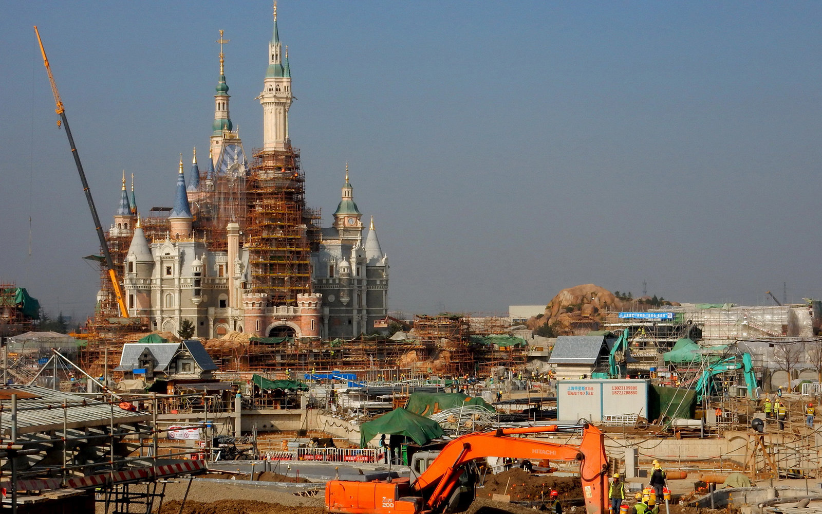 SHANGHAI, CHINA - DECEMBER 26: (CHINA OUT) Disneyland is under construction on December 26, 2015 in Shanghai, China. Shanghai Disneyland would open on Children's Day of 2016. (Photo by Zhang Heping/ChinaFotoPress via Getty Images)