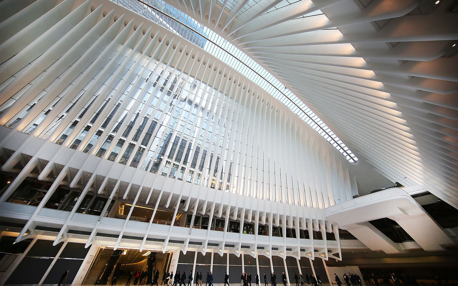 NEW YORK, NY - MARCH 07:  Commuters walk through the Oculus of the partially opened World Trade Center Transportation Hub after nearly 12 years of construction on March 7, 2016 in New York City. The grand structure was designed by Spanish architect Santia