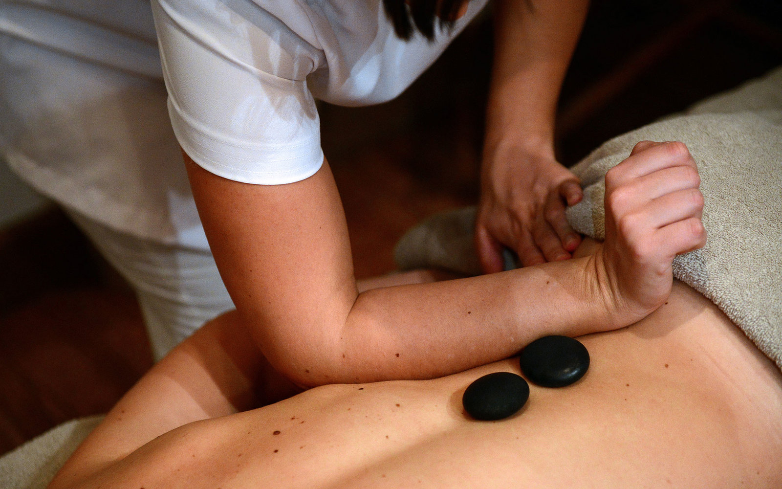 An employee gives a massage to a client at the luxury hotel  Les Barmes de l'Ours , on December 13, 2012 in Val d'Isere, French Alps. AFP PHOTO / FRANCK FIFE        (Photo credit should read FRANCK FIFE/AFP/Getty Images)