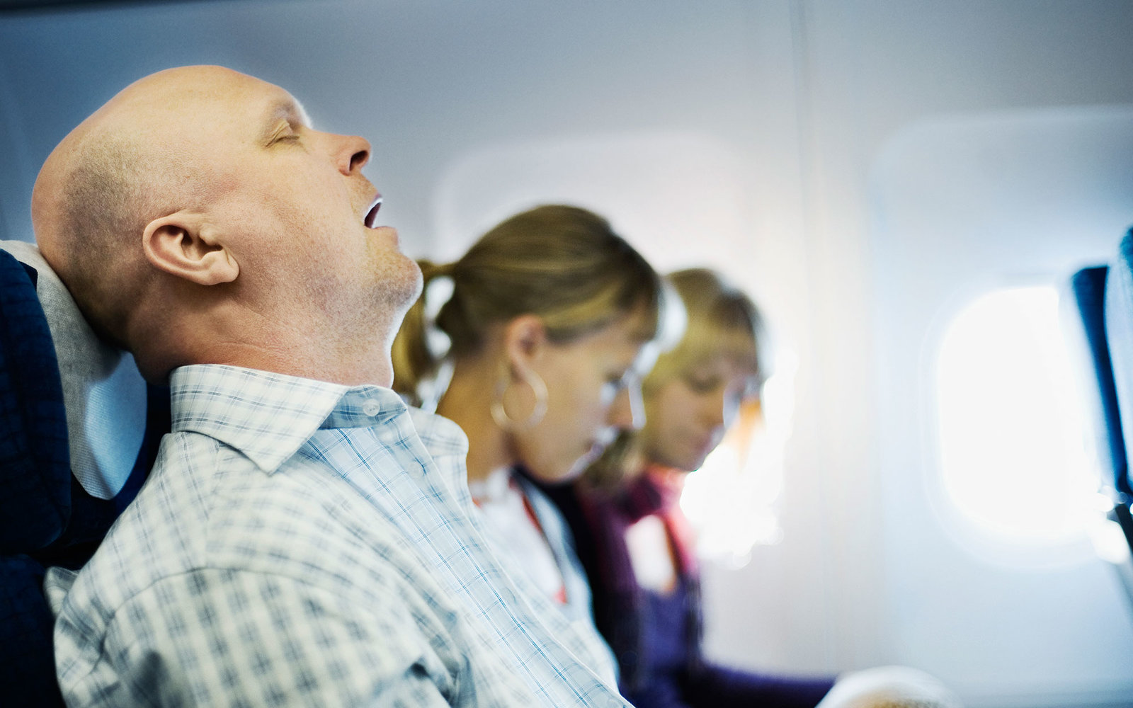 Man sleeping in airplane