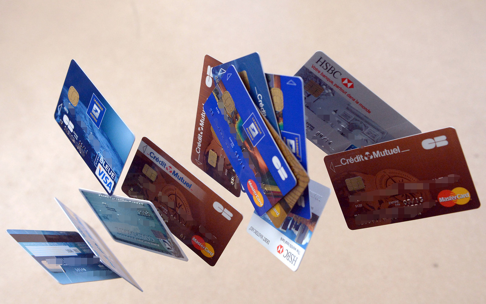 Credit cards falling down are pictured, on February 5, 2013  in Rennes, western France. French police has arrested, early this morning in Paris and in several French and overseas departments, 22 people in connection with the trade of credit cards numbers