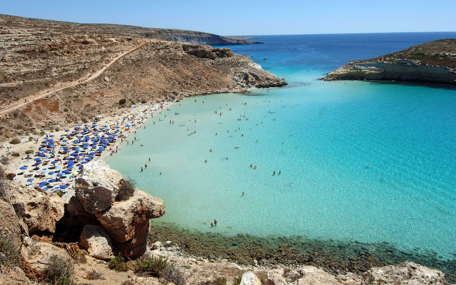 """ITALY - SEPTEMBER 04:  The """"Spiaggia dei Conigli"""" or Rabbit Beach in Lampedusa, Italy, Monday, September 4, 2006. With its sun-kissed beaches and crystal-clear sea, Lampedusa could be a playground for the rich and famous. Instead, the 20-square-kilometer"""