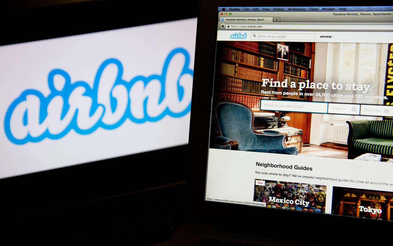 The Airbnb Inc. logo and website are displayed on laptop computers in this arranged photograph in Washington, D.C., U.S., on Friday, March 21, 2014. Airbnb Inc. is raising money from investors including TPG Capital in a financing round that would value th